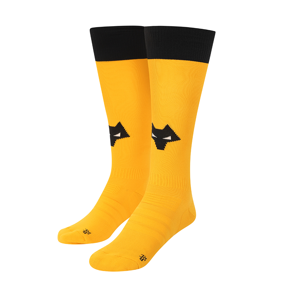 2021-22 Wolves Home Sock - AdultBe Part Of the Pack, with the 2021-22 Wolves Home Sock and show your pride on the streets and in the stands.Featuring a Wolves head incorporated into front and centre of the sock, to show prominently on and off field.Polyamide 98%Elastane 2%