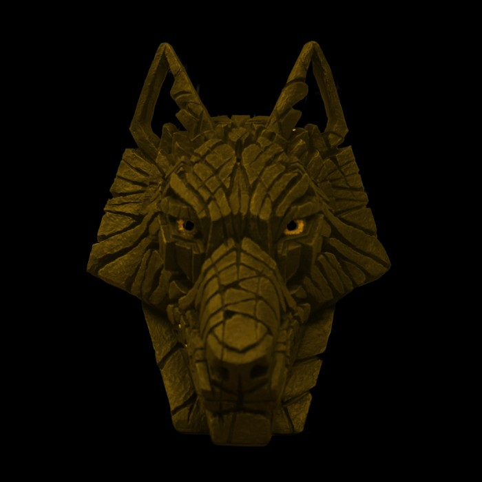 Gold wolf head sculpture